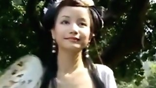 Beautiful Asian Female Ambles Thru A Garden